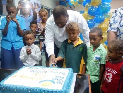 CBSI Governor Denton Rarawa helping to cut the cake to mark the launching. Photo credit: SIBC.