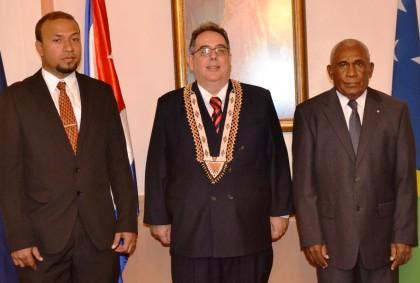 Deputy Secretary of Foreign Affairs and External Trade William Soaki, Ambassador Montano and Sir Frank Kabui at Government House. Photo credit: GCU.