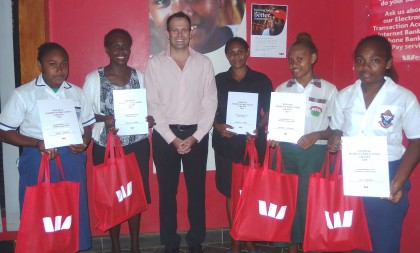 Winners of the Westpac Women's Education Grant 2015. From left to right. Deslie Legahile, Jenelle P Raddie, Mr. Elliott Griffin, General Manager, Westpac, Damaris Manea, Stephany Veronica, Lucy Keniore. Photo credit: Westpac.