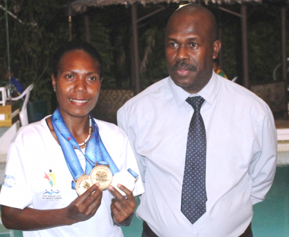 Deputy Prime Minister and Home Affairs Minister Douglas Ete, right, with triple gold medalist Sharon Firisua at the awards night at Honiara Hotel. Photo credit: OPMC.