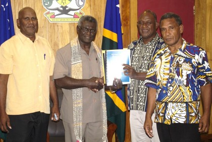 Fiu Hydro Chairman Alfred Gegeo hands over the strategic plan to PM Sogavare as two members look on. Photo credit: OPMC.