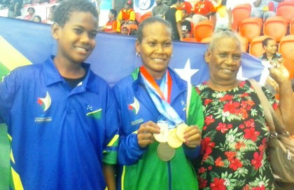 Jenly Wini and family members with her medals. Photo credit: SIBC.