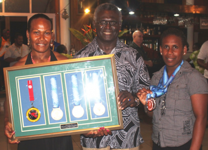 PM Sogavare with weightlifters Jenly Tegu Wini and Mary Kini Lifu. Ms Wini snatched 3 gold medals whilst Ms Lifu secured two silver medals. Photo credit: OPMC.