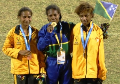 Sharon Firisua who took gold in the women's 5,000 metres, celebrating with PNG athletes. Photo credit: www.insidethegames.biz