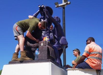 US Marines repainting the Solomon Islands Scouts monument in Honiara. Photo credit: SIBC.