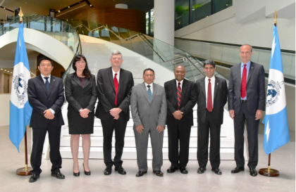 Center from left Police Commissioner Frank Prendergast, Minister Agovaka and PS Edmond Sikua with staff of the INTERPOL Global Complex for Innovation in Singapore last week. Photo credit: GCU.