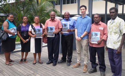 Permanent Secretary Ethel Sigimanu (third left) with research stakeholders displaying the report. Photo credit: SIBC.