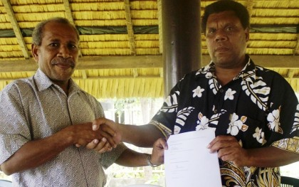 The Minister of Provincial Government Dudley Kopu and Makira Ulawa Premier Thomas Weape with the signed documents. Photo credit: OPMC.