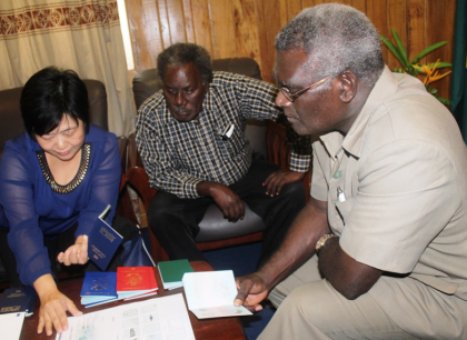 Prime Minister Sogavare holding a sample e-passport. Photo credit: OPMC.