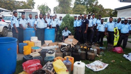 RSIPF Officers with some of the Kwaso manufacture equipment seized during raids. Photo credit: RSIPF.