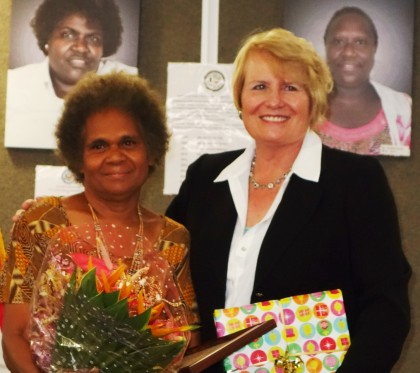 Dr Alice Pollard and US Ambassador, Her Excellency Catherine Ebert Grey with the award. Photo credit: SIBC.
