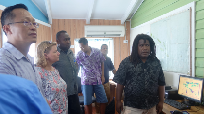 Director of Meteorology David Hiriasia briefing members of a team who visited the Met Office in Honiara recently. Photo credit: SIBC.