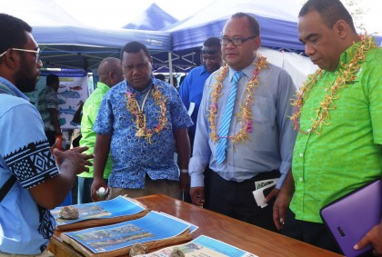 MECDM Minister Samuel Manetoali and PS Dr Melchior Mataki briefed on some of the displays yesterday. Photo credit: SIBC.