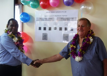 Selwyn Riumana shaking hands with the solar system provider from Australia. Photo credit: SIBC.