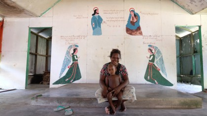 Victoria, from Kuila Village, spoke to the team about development issues in her village. This is her in the catholic church which was half-built, then abandoned.