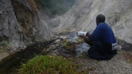 Frederic Ninizepo cooking  kasava and megapode eggs in the boiling water of the volcano