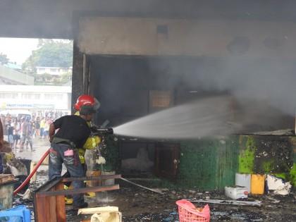 Firefighters spraying down the blaze