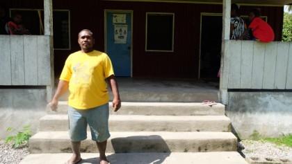 Benjamin Kakau on the steps of the clinic