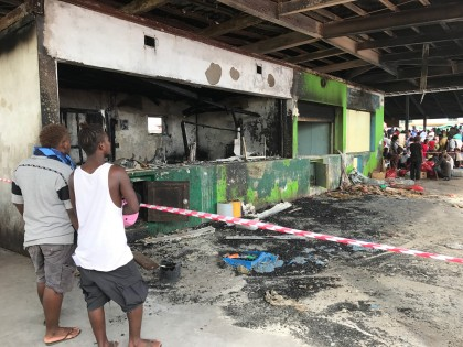 Market goers assessing the damage this morning. The market was operating as normal.