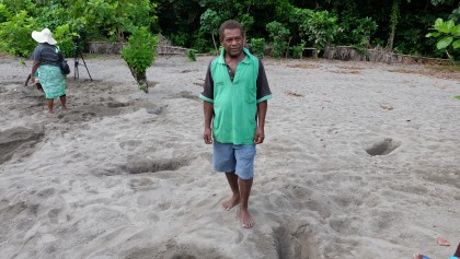 Chief Chris Nivou standing in the megapode field.