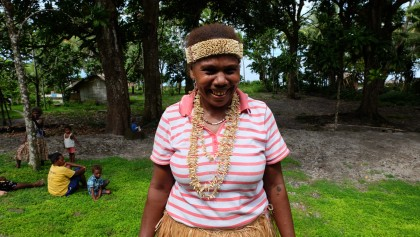 Deborah Vasuni poses with the traditional dolphin teeth jewellery after performing a traditional dance