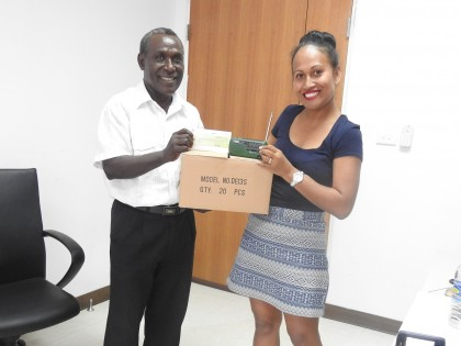 MP for NW Choiseul Constituency, Hon. Connelly Sadakabatu with SIBC sales manager Gloria Hong