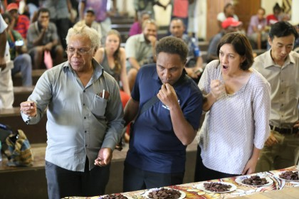 Some of the attendees tasting the chocolate on display
