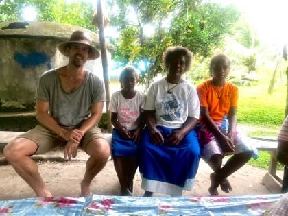 A tourist meets some local Solomon Islanders